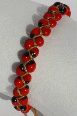 Bracelet et graines huayruro rouges