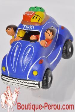 Taxi péruvien bleu en céramique.
